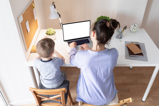 Home work concept. Working from home during the coronavirus pandemic COVID-19. Mother telecommuting while her child playing