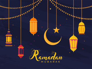 Islamic Holy Month of Ramadan Concept with Hanging Illuminating Lanterns, Moon, and Star on Blue Background. Fototapete