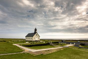 Coastal landscape with little Strandarkirkja Church, Selvogur, Sudurland, Iceland