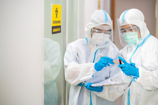 Asian doctor show corona or covid-19 blooding tube wearing ppe suit and face mask in hospital. Corona virus, Covid-19, virus outbreak, medical mask, hospital, quarantine or virus outbreak concept
