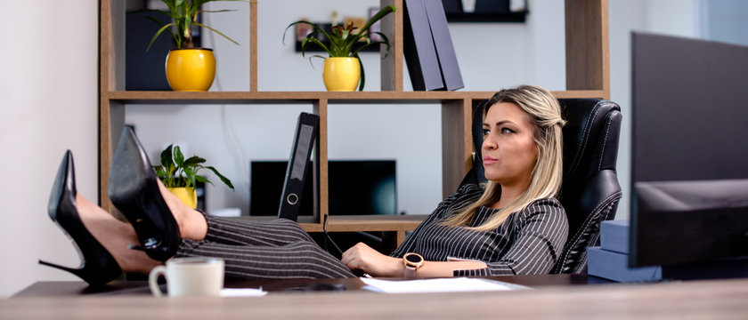 Blonde business woman relaxing