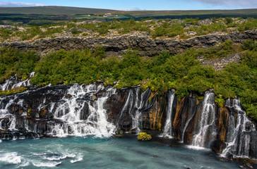 Cascades of scenic Hraunfossar, Iceland