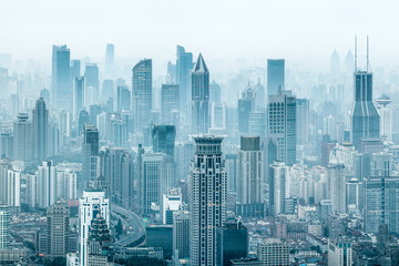 Aerial view of the Shanghai skyline with skyscrapers covered in smog, China Fotobehang