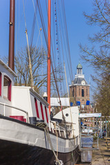 Fotomurales - Old sailing ship and church tower in Meppel, Netherlands