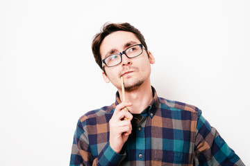 man is thinking about something with pencil