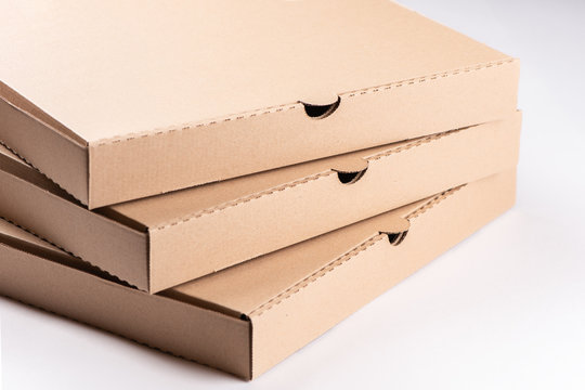 Stack of cardboard pizza boxes on white background