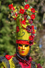 Beautiful and colourful costume and mask at the Venice Carnival in Annecy by day, France