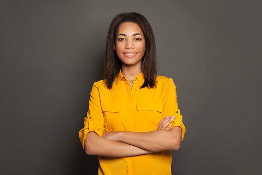 Smiling black woman in yellow shirt portrait