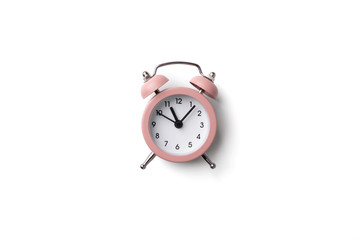 Pink alarm clock isolated on white background with copy space