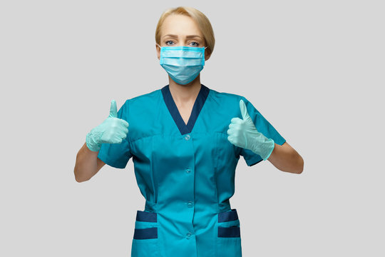 medical doctor nurse woman wearing protective mask and latex gloves - showing big thumb up