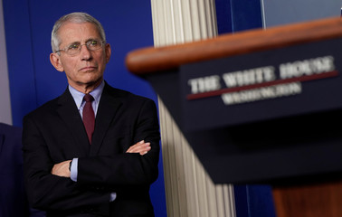 Dr. Anthony Fauci listens during the daily coronavirus response briefing at the White House in Washington