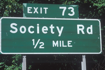 Wall Mural - A sign that reads Society Road 1/2 mile