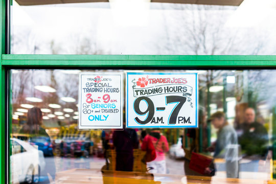 Reston, USA - April 1, 2020: Trader Joe's grocery store window sign for senior customers with special morning and regular open hours for old people during covid-19 coronavirus disease outbreak