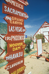 Fototapete - Miscellaneous distance signs in Arizona