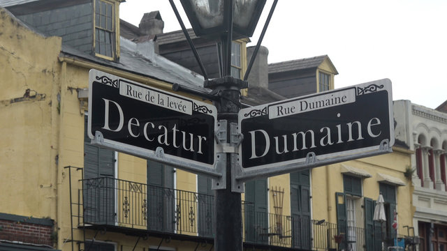 Street signs Decatur street and Dumaine street in New Orleans
