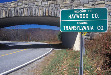 Wall Mural - A sign that reads ÒWelcome to Haywood Co.; Leaving Transylvania Co.Ó