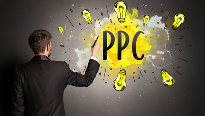 businessman drawing colorful light bulb with PPC abbreviation, new technology idea concept