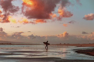 Solitary Surfer At Sunset