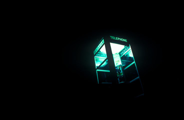 Telephone booth at night with interior lights