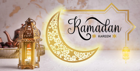 Muslim lamp and text RAMADAN KAREEM on light background