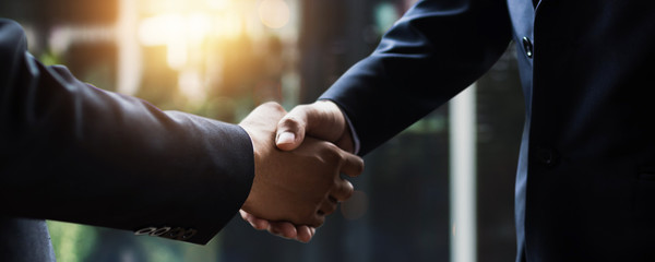 successful negotiate and handshake concept, two businessman shake hand with partner to celebration partnership and teamwork, business deal Fotobehang