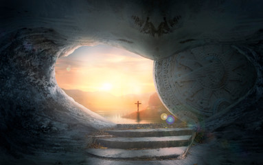 Easter Sunday concept: Tomb empty with cross on sunset background Fotomurales