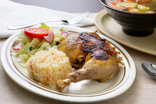A view of a Latin American dish called arroz con pollo, which means rice and chicken, in a restaurant or kitchen setting.