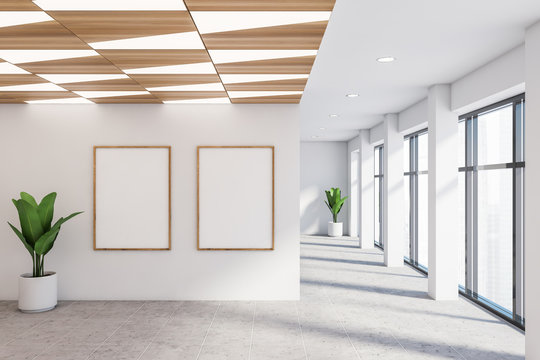 Empty white office hall with posters