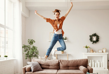 Excited millennial woman listening to music and having fum at home Fotobehang
