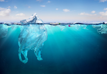 Plastic Pollution In Ocean - Plastic Bag Floating On Sea - Environmental Problem