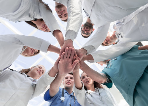 bottom view. diverse medical professionals showing their unity.