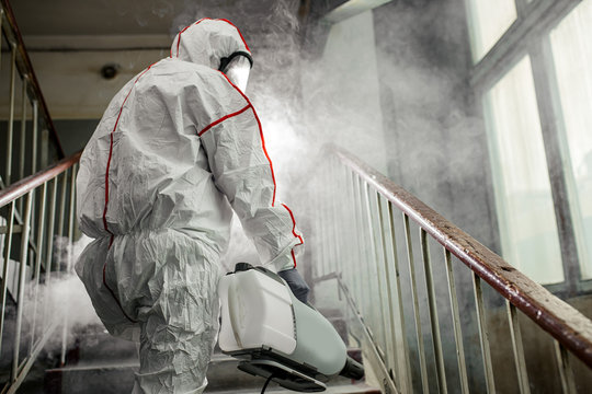 coronavirus pandemic, disinfection against COVID-19 virus. professional disinfector in protective clothing, suit fight with pandemic health risk, remove bacterias and infections use special equipments