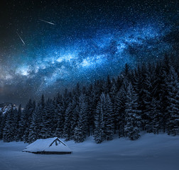Poster de jardin Bleu nuit Milky way over wooden cottage in Tatra mountain in Poland