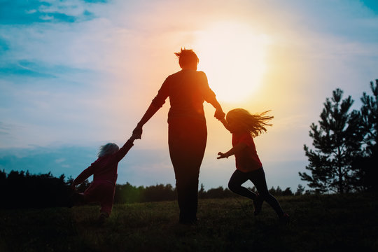 happy mother with kids play in nature
