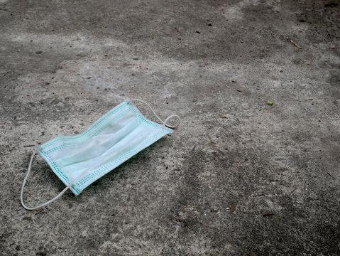 used medical mask on the floor concept corona virus,covid-19