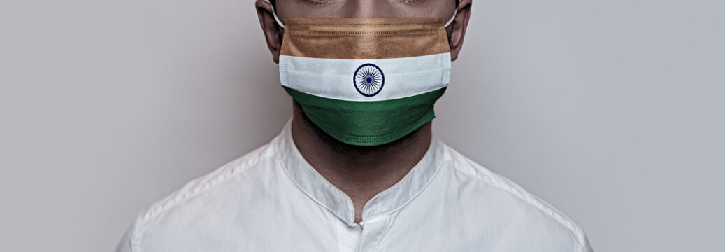 Corona virus pandemic. Concept of Corona virus quarantine, Covid-19. The male face is covered with a medical mask