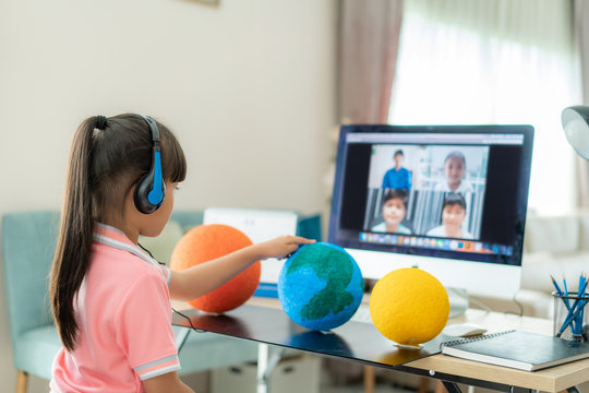 Asian girl student live learning video conference with teacher and other classmates giving presentation, showing solar model project, Homeschooling and distance learning ,online ,education.