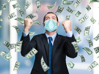 Businessman enjoying a rain of money while wearing a mask, coronavirus business opportunities concept