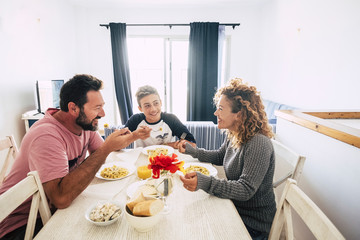 Concept of stay home lockdown quarantine people - caucasian family at home do lunch together enjoying the time - white house and italian food - people with different ages and generations Fototapete