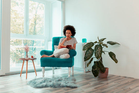 Woman reading a book at home