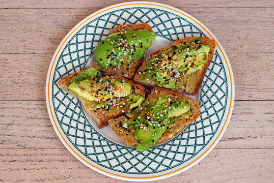 Plate of avocado toast with Everything but the Bagel seasoning on top
