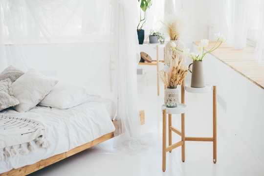 Modern boho interior. Dried flowers in a modern interior. Interior decor in eco-style.