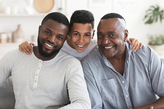 Happy black son, father and grandfather posing for family picture together