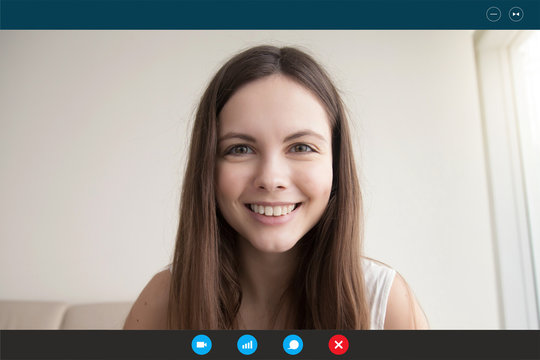 During self-isolation people contact with friends by videocall use videoconference app due to pandemic coronavirus outbreak. Young woman looks at webcam face view, video call e-date services concept