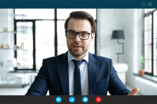 Head shot employer lead job interview with applicant laptop screen teleconference app view. Businessman talk with client by video call communicating distantly use modern videoconference and pc concept
