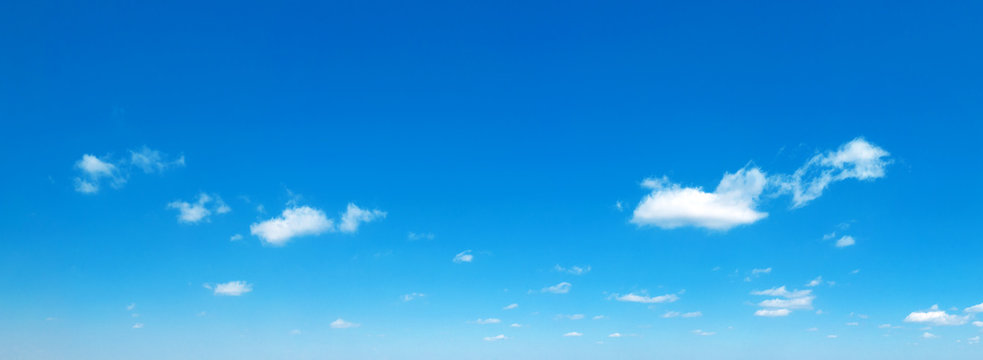 Blue sky background. Natural background. Panorama sky with tiny clouds