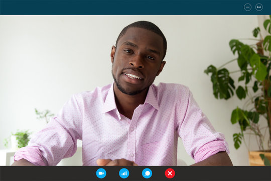 Computer screen webcam view African man pass job interview distantly by videoconference app. American english teacher teaches trainee via video call, easy and remote communication, modern tech concept