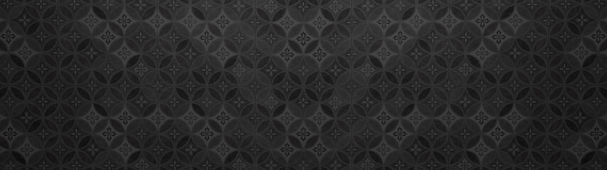 Old black anthracite vintage shabby patchwork mosaic motif tiles stone concrete cement wall texture background with circle print