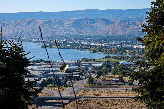 Aerial landscape of Wenatchee Valley Washington with the Columbia river running through the valley.  Cityscape with streets and mountains.  Wenatchee is found in Chelan County in the Pacific Northwest