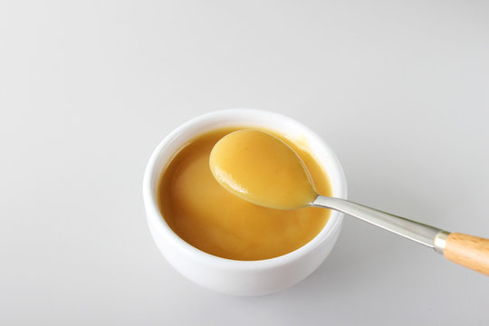 puree baby in a glass on a light background